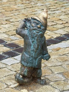 You can spot sculptures of dwarfes all around the city.